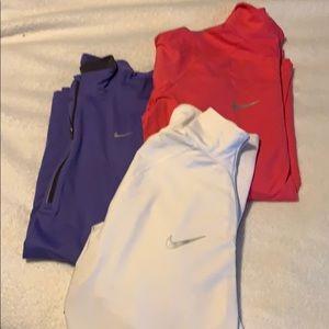 Women's Nike Dri-Fit 3 quarter zip pullovers
